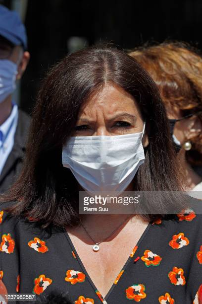 Mayor of Paris Anne Hidalgo wearing a protective face mask attends the reopening of the square of Notre Dame cathedral on Pentecost Sunday on May 31...
