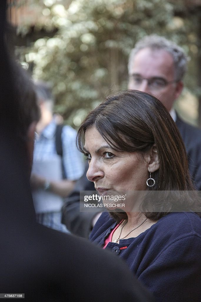 Mayor of Paris Anne Hildago discusses during the inauguration of the school complex Olivier de Serres, a model of urban ecology in Paris, on June 4, 2015.