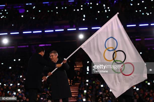 Mayor of PyeongChang Sim Jaeguk and President of the International Olympic Committee Thomas Bach participate in the Olympic flag handover ceremony...