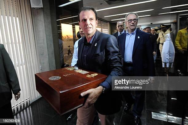 Mayor of Rio de Janeiro Eduardo Paes and the President of Rio 2016 Commite Carlos Arthur Nuzman arrive at the international airport of Rio de Janeiro...