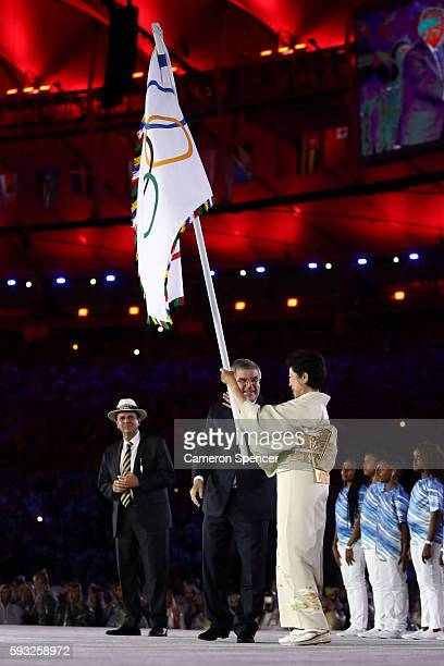 Mayor of Rio de Janeiro Eduardo Paes IOC President Thomas Bach and Governor of Tokyo Yuriko Koike stand on stage for the Flag Handover Ceremony...