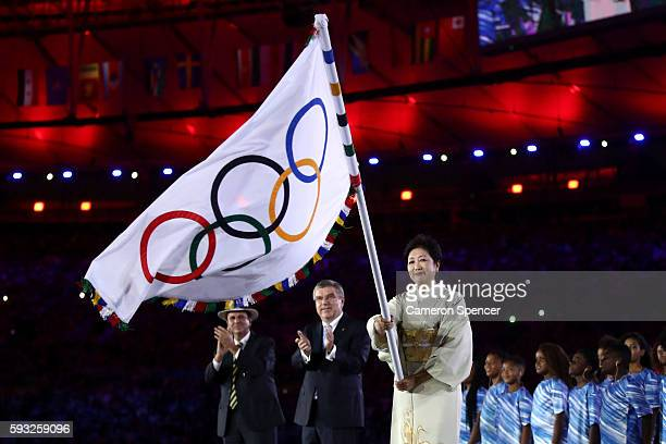 Mayor of Rio de Janeiro Eduardo Paes, IOC President Thomas Bach and Governor of Tokyo Yuriko Koike take part in the Flag Handover Ceremony during the...