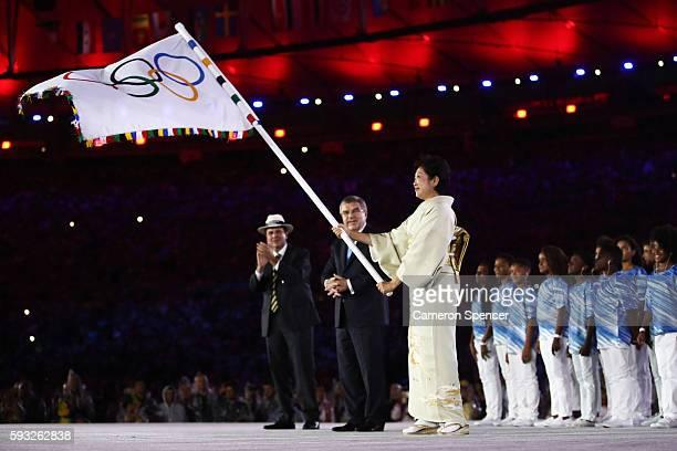 Mayor of Rio de Janeiro Eduardo Paes IOC President Thomas Bach and Governor of Tokyo Yuriko Koike take part in the Flag Handover Ceremony during the...