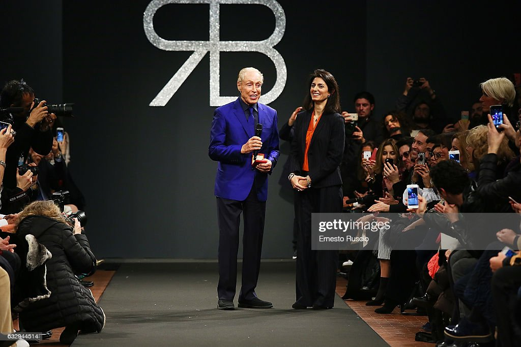 Mayor of Rome Virginia Raggi and designer Renato Balestra attend the runway of the 'Renato Balestra' fashion show during AltaRoma January 2017 on January 28, 2017 in Rome, Italy.