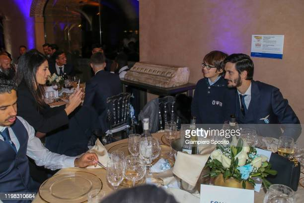 Mayor of Rome Virginia Raggi takes a picture as her son poses with soccer player Luis Alberto of SS Lazio during a dinner to celebrate the 120th...