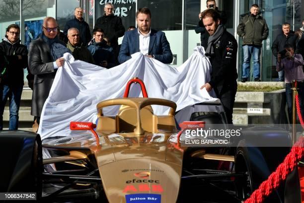 Mayor of Sarajevo Abdulah Skaka Formula E French driver JeanEric Vergne and coowner of Techeetah Formula E team Edmund Chu unveil Formula E car after...