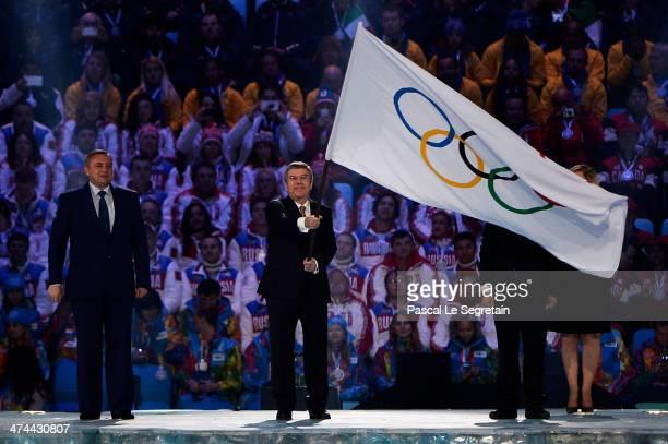 Mayor of Sochi Anatoly Pakhomov and Mayor of Pyeongchang Lee Seok-rae look on as President of the International Olympic Committee Thomas Bach waves...