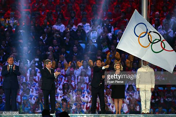 Mayor of Sochi Anatoly Pakhomov President of the International Olympic Committee Thomas Bach and Mayor of Pyeongchang Lee Seokrae during the flag...