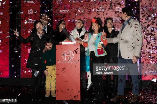 Mayor of the city of Paris Anne Hidalgo actress Lily Rose Depp and Jeanne d'Hauteserre attend the Christmas lights launch on the ChampsElysees avenue...