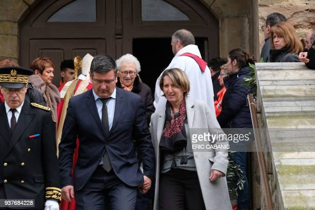 Mayor of Trebes Eric Menassi and his wife Director of Super U supermarket Samia Menassi leave a service of remembrance to victims at the Saint...