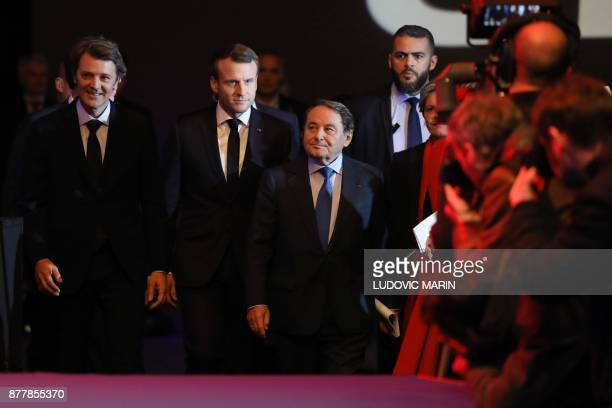 Mayor of Troyes and President of the Association of Mayors of France Francois Baroin, French President Emmanuel Macron and Mayor of Issoudun and...