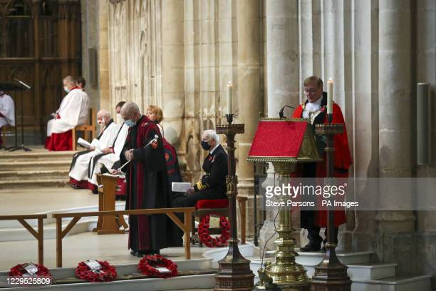Mayor of Winchester, Cllr Patrick Cunningham , reads out a reading during a remembrance service at Winchester Cathedral on Remembrance Sunday.