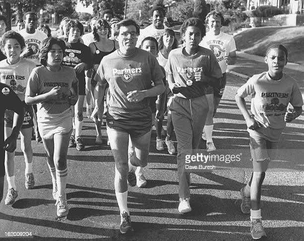 JUL 5 1983 JUL 6 1983 Mayor Pena Wade Manning and Larry Evans of the Broncos did a running stint with the people from partner at Sloans Lake They...