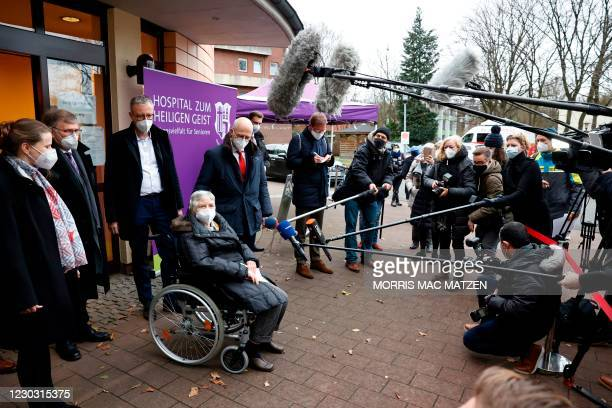 Mayor Peter Tschentscher , senator for social affairs Melanie Leonhard and 84 year old Karin Sievers speaks to media after she became the first to be...