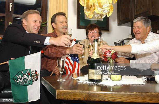 Mayor Peter Urdl celebrates with Arnold Schwarzenegger's former schoolmates Josef Heinzl with wife Gattin and Franz Hormann as they watch...