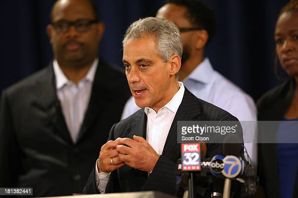 Mayor Rahm Emanuel addresses a crowd gathered for a prayer service at New Beginnings Church for the victims of yesterday's mass shooting on September...