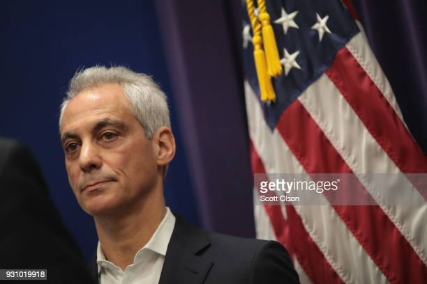 Mayor Rahm Emanuel listens to a speaker during a press conference with community activists local politicians and families of gun violence victims...