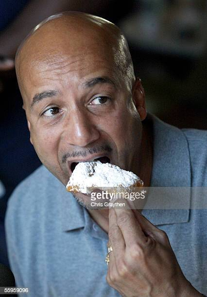 Mayor Ray Nagin eats a beignet at the opening of Cafe Du Monde on October 19 2005 in New Orleans Louisiana The famous cafe reopened after being...