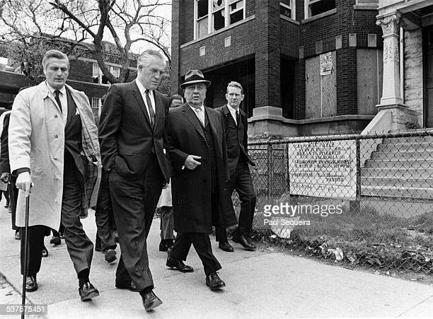 Mayor Richard J Daley third from left walks with Housing and Urban Development chief George Romney second from left during a walking tour of...