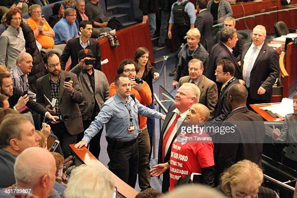 Mayor Rob Ford, accompanied by a supporter and security guard, tours the gallery and confronts opponents during a Toronto City Council on November...