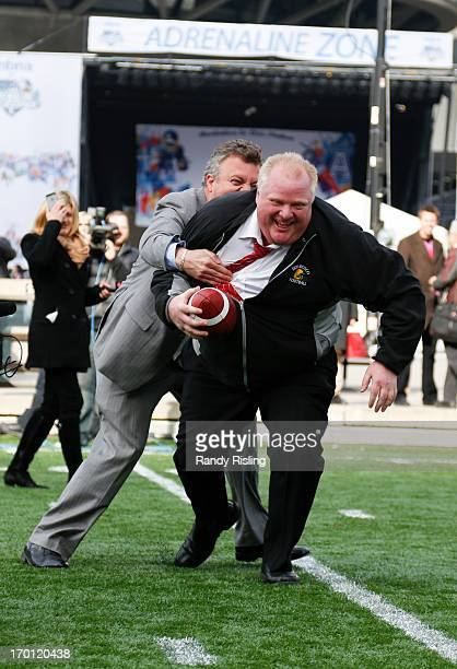 Mayor Rob Ford gets tackled by his PressSecretary George Christopoulos during Grey Cup celebrations at the CFL Adrenaline Zone at Nathan Phillips...