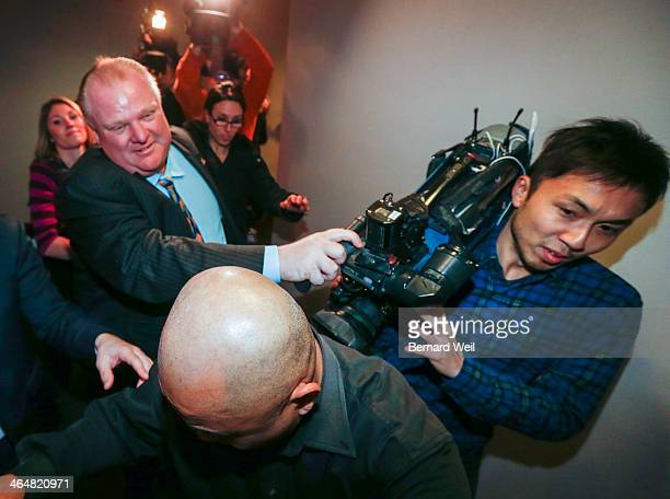 TORONTO ON JANUARY 23 Mayor Rob Ford grabs the camera of Fairchild cameraman Tai Lam aside as he heads to the bathroom after missing for more than an...