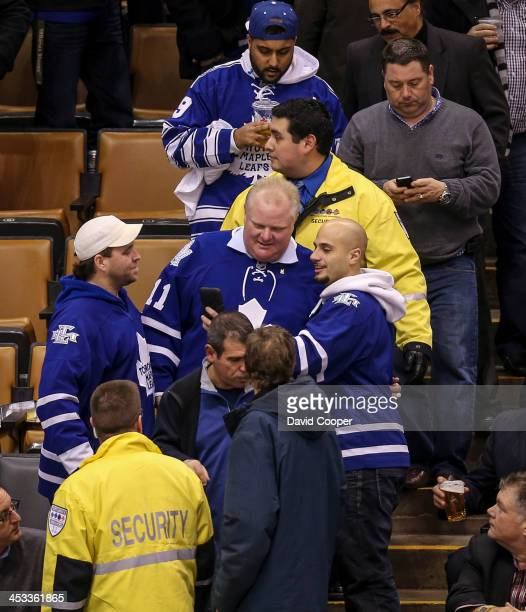 Mayor Rob Ford leaves his seat behind the San Jose Sharks bench with a few minutes to go in the 3rd period as the Toronto Maple Leafs take on the San...
