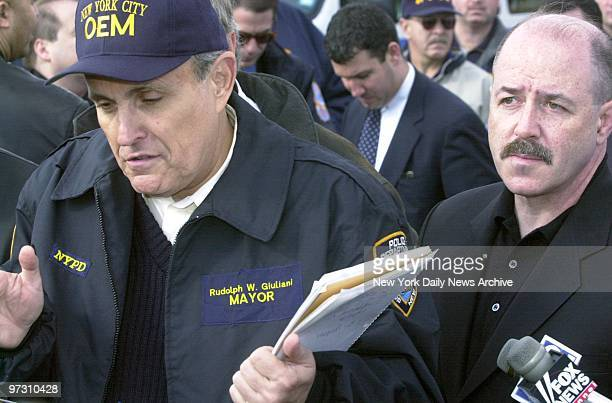 Mayor Rudy Giuliani and Police Commissioner Bernard Kerik arrive at the scene of American Airlines flight 587 after it crashed in the Rockaway...