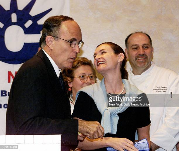 Mayor Rudy Giuliani draws a smile from Cristyne LateganoNicholas head of the Convention and Visitors Bureau at Eleven Madison Park restaurant They...