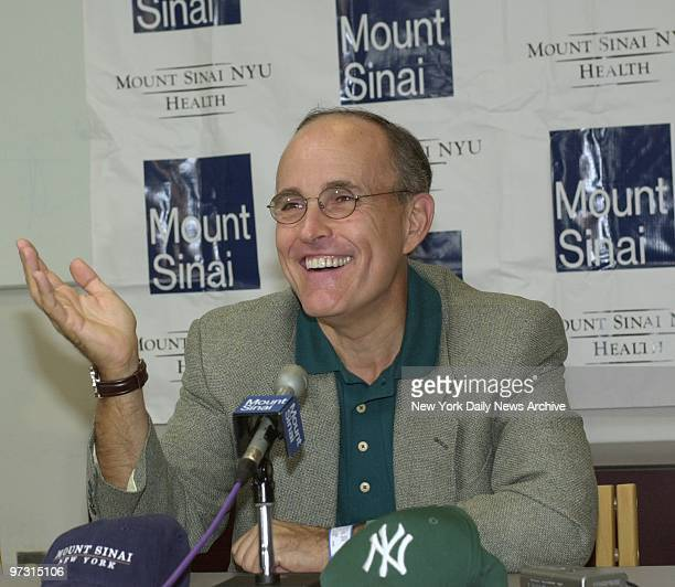 Mayor Rudy Giuliani speaks to the media at Mount Sinai Hospital after receiving radioactive seed implants to combat his prostate cancer