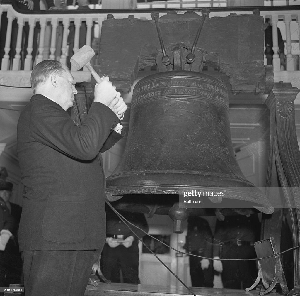 Mayor S. Davis Wilson, of Philadelphia, Pennsylvania, striking the Liberty Bell, once for each ratification of the Constitution by the respective states, as Philadelphia, Pennsylvania celebrated the 150th anniversary of the signing of the Constitution, September 17th.