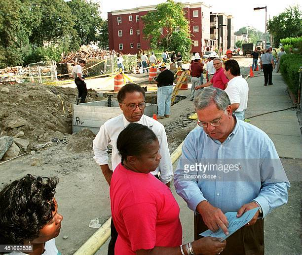 Mayor Thomas Menino after surveying the damage to the triple decker that exploded from a gas leak on Ashton Street mingles with neighbors after...