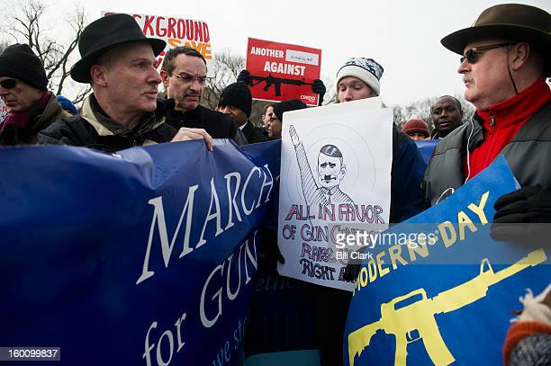 Mayor Vincent Gray of Washington DC marches past gun rights advocates on January 26 2013 in Washington DC Gun control activists marched from the US...
