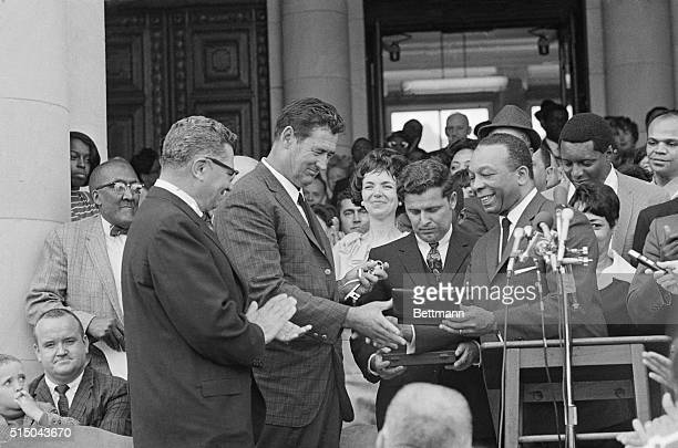 Mayor Walter Washington presents the keys to the city to new Washington Redskins coach Vince Lombardi and new Washington Senators Manager Ted...