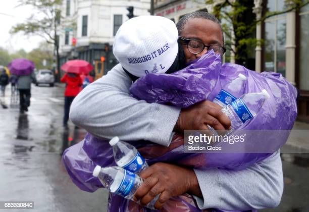 Mayoral candidate and Boston City Councilor Tito Jackson embraces Ursula Ward the mother of Odin Lloyd who was murdered by former Patriots player...