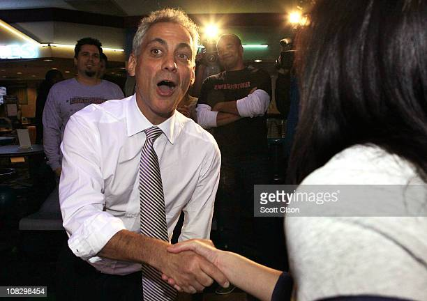 Mayoral candidate and former White House Chief of Staff Rahm Emanuel greets voters during a campaign stop at a bowling alley January 24 2011 in...