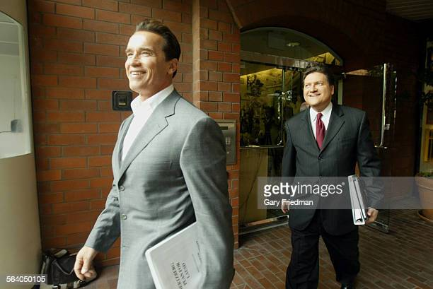 Mayoral candidate Bob Hertzberg follows Governor Arnold Schwarzenegger for a press briefing following Hertzberg's meeting with the governor on...