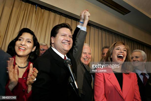Mayoral candidate Bob Hertzberg joins hands with former Los Angeles mayor Richard Riordan during an election night party inside the Balboa Ballroom...