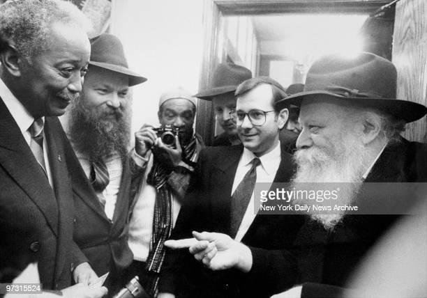 Mayoral candidate David Dinkins and Councilman Noach Dear talk with Lubavitcher Rebbe Menachem Schneerson and Rabbi Joseph Spielman Crown Heights...