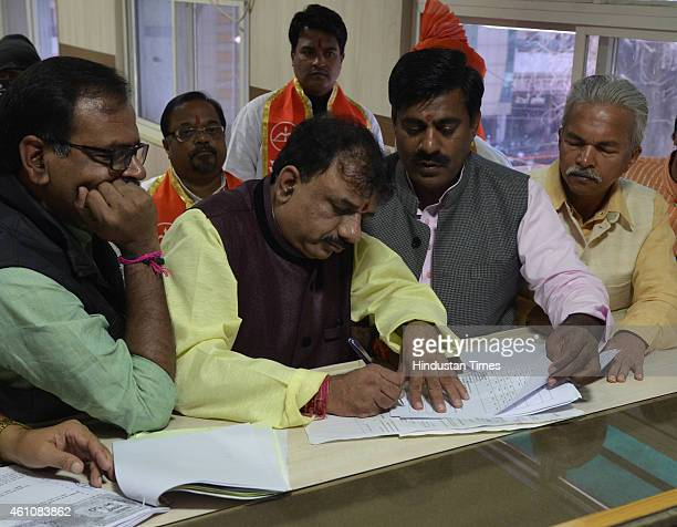 Mayoral candidate for Bhopal, Alok Sharma filing his nomination at the collectorate on January 6, 2015 in Bhopal, India. Elections for the mayors of...
