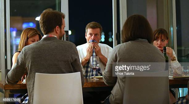 Mayoral candidate John Tory and his wife Barbara Hackett and guests have dinner at Corey Mintz's home