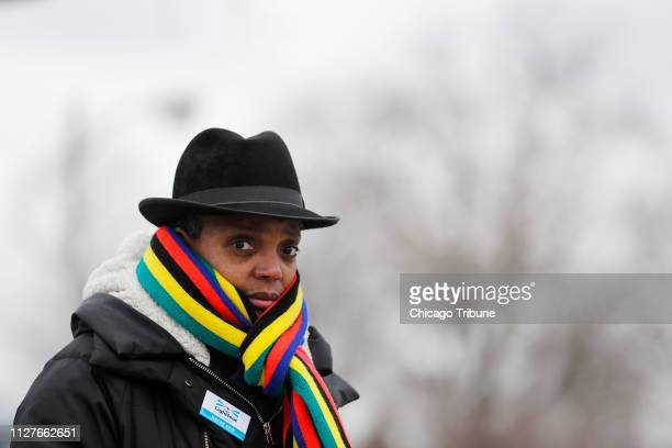 Mayoral candidate Lori Lightfoot campaigns and talks to voters outside of polling station at Tuley Park Cultural Center in Chicago on Election Day...