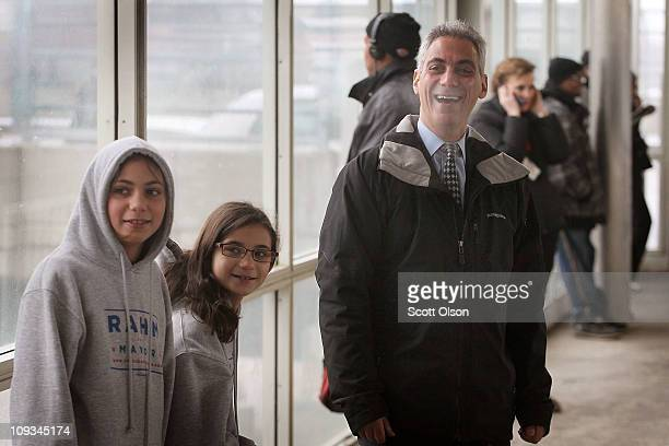 Mayoral candidate Rahm Emanuel greets commuters with his daughters Ilana and Leah at an L train station while campaigning February 22 2011 in Chicago...