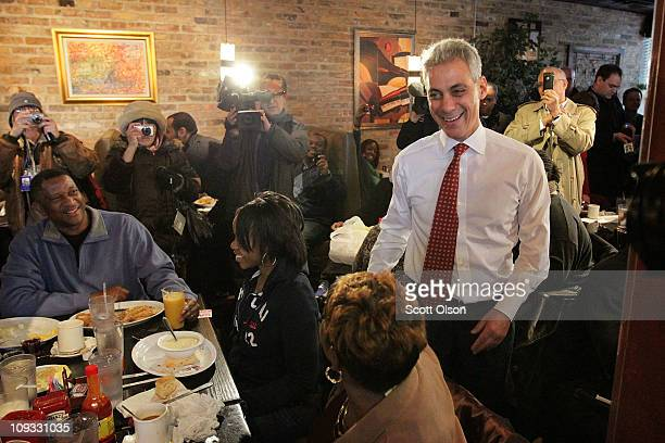 Mayoral candidate Rahm Emanuel greets diners at Chicago's Home of Chicken and Waffles restaurant during a campaign stop February 21 2011 in Chicago...