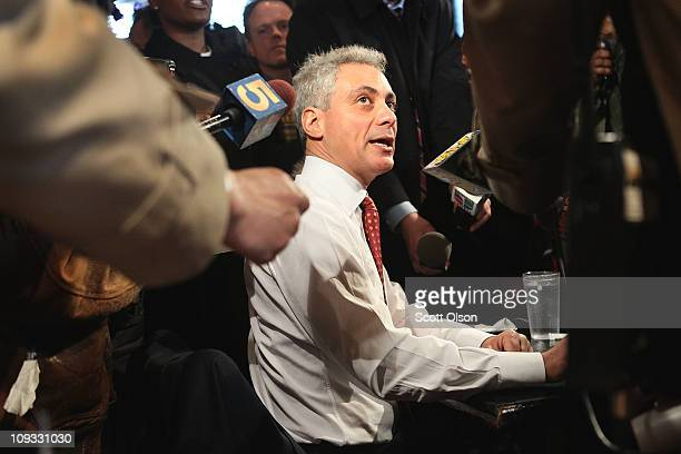 Mayoral candidate Rahm Emanuel talks with reporters while having lunch at Chicago's Home of Chicken and Waffles restaurant during a campaign stop...