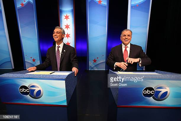 Mayoral candidates former White House Chief of Staff Rahm Emanuel and Gery Chico wait for the start of a debate at the Oriental Theater February 17...