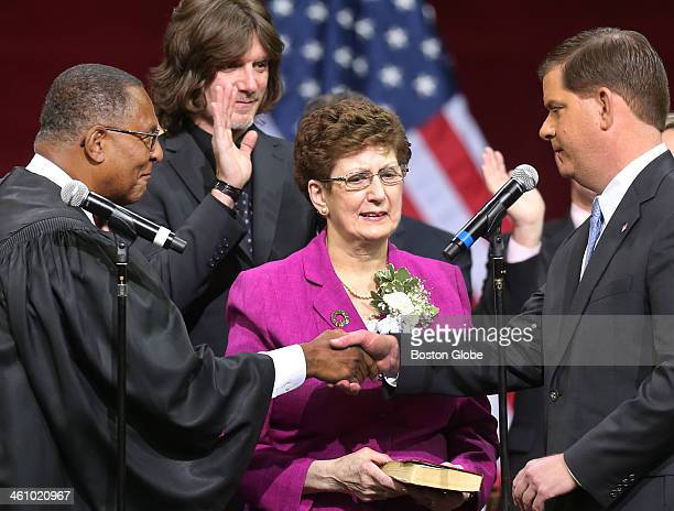 Mayorelect Marty Walsh right shakes hands with Roderick L Irelend Massachusetts Supreme Court Justice left at his inauguration ceremony at Boston...