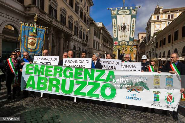 Mayors and citizens of Italy's Abruzzo region demonstrate to denounce the state of abandonment in which lie the areas affected by the earthquake and...