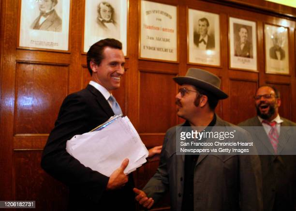 Mayorsrace11_0110_df.jpg ;Chicken John Rinaldi , in hat, had a chance run in with Mayor Gavin Newsom, at left, as he gets a tour of the mayors office...