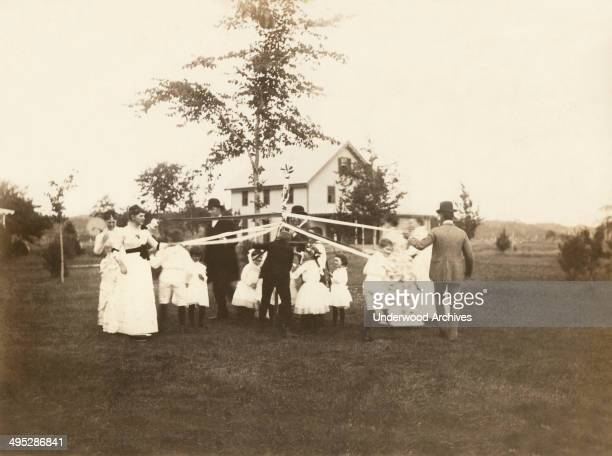 A Maypole dance for a girl's birthday celebration Niantic Connecticut July 1885